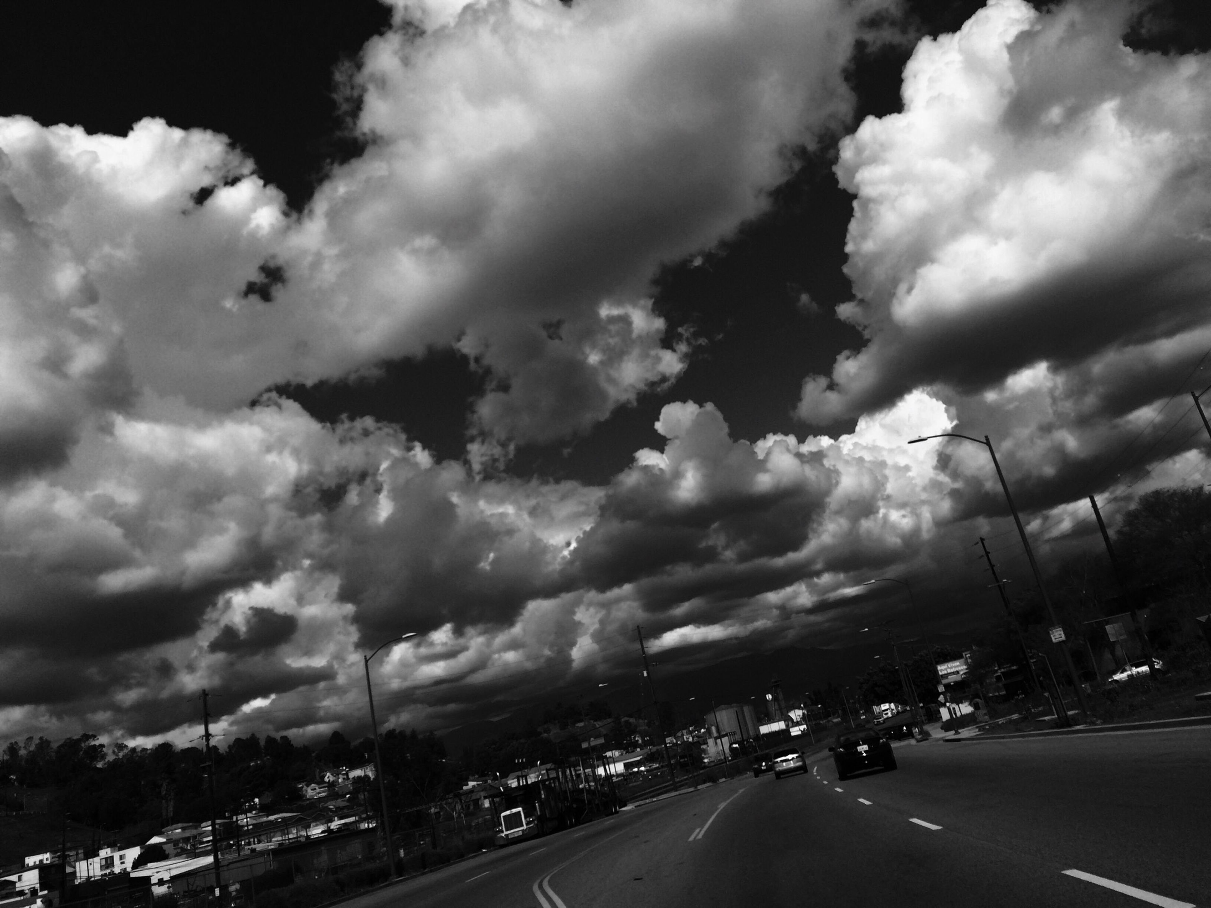 sky, transportation, cloud - sky, road, cloudy, car, cloud, the way forward, street, land vehicle, weather, road marking, overcast, mode of transport, nature, mountain, outdoors, landscape, storm cloud, tree