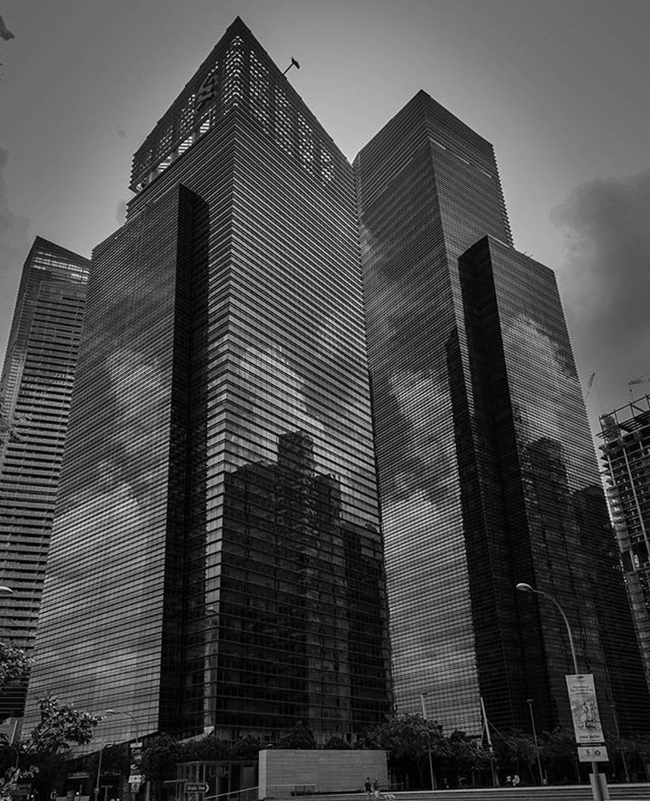 Love how the clouds reflected on the building's in this shot Cbdsingapore Singapore ASIA Nature Cityscapes Photooftheday Skyline Blackandwhitephoto InstaTags4Likes Instagram Sonyrx100iv