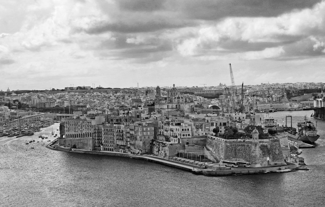 Overlooking Valletta Harbour - Malta Moody Sky. Architecture Blackandwhite Photography Building Exterior Built Structure City Cityscape Day Malta♥ No People Outdoors River Sky Transportation Valletta Harbour Water EyeEm Selects