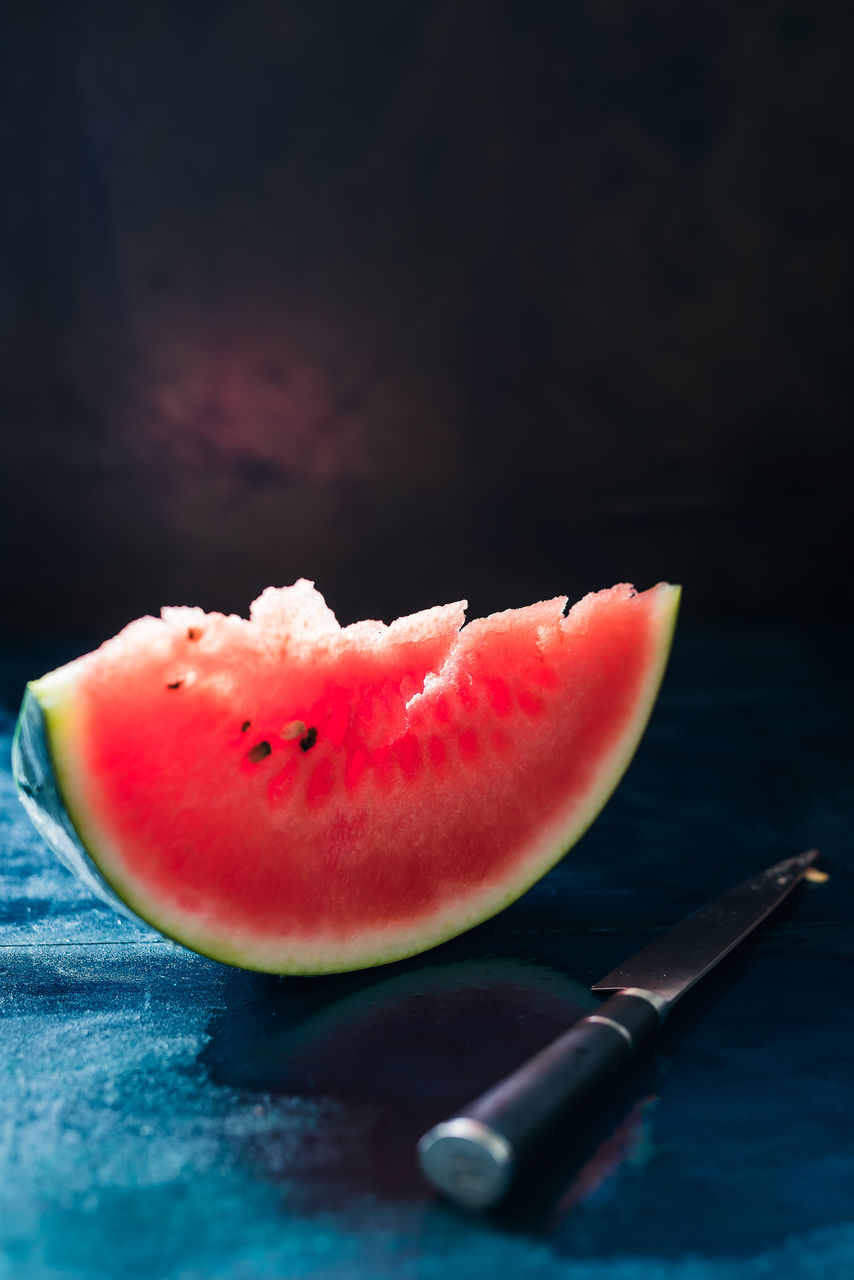 Close-Up Of Watermelon Slice On Table
