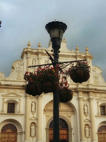 The light in front of Sam Jose Cathedral. Street Light Architecture Building Exterior Sky Outdoors City Travel Destinations Tourism Built Structure Flowers Light Guatemala Antigua Guatemala Park Cathedral Statues Church Church Architecture Day Cathedral San Jose Door