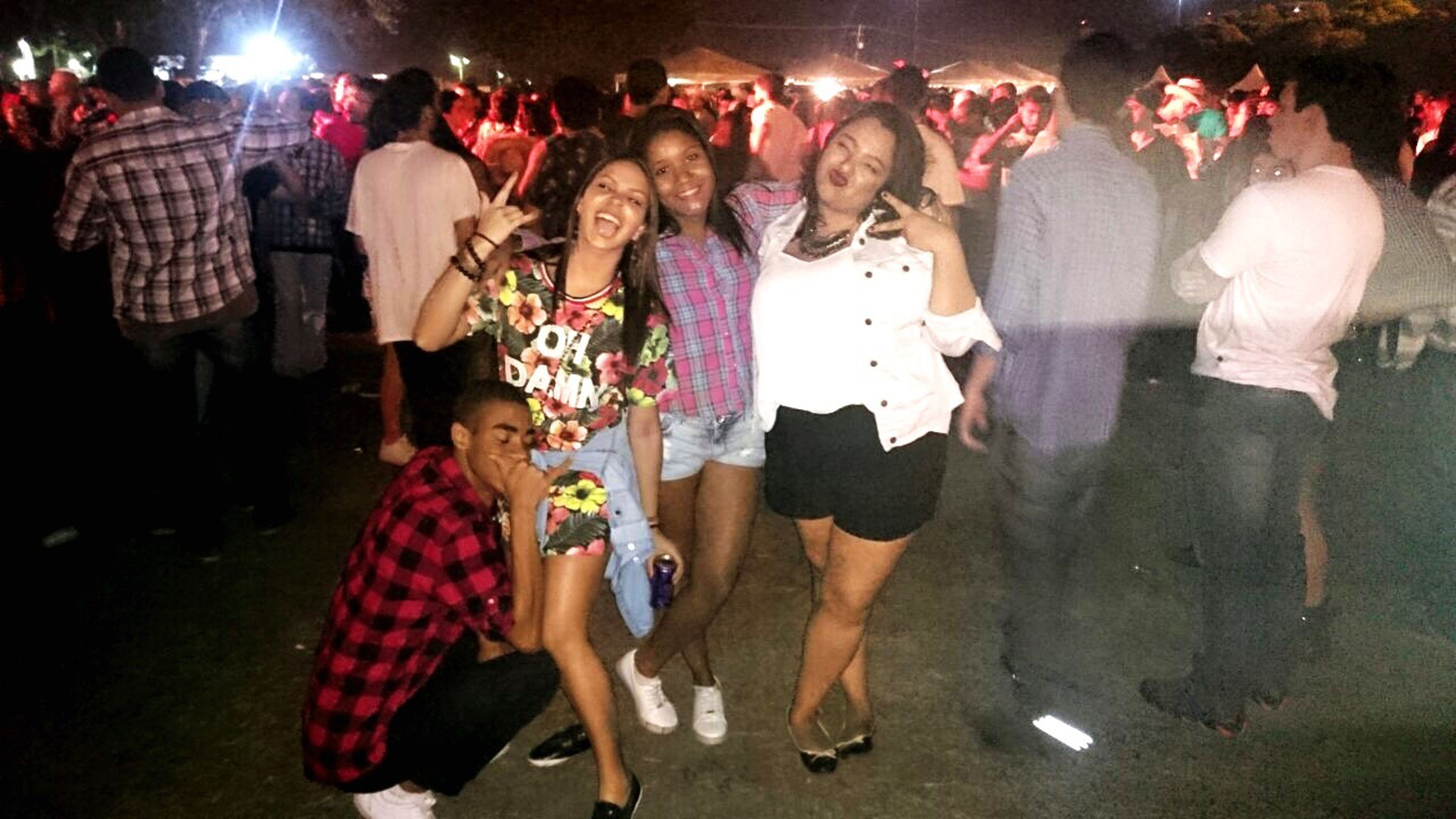 lifestyles, person, large group of people, leisure activity, illuminated, night, standing, celebration, crowd, enjoyment, casual clothing, arts culture and entertainment, performance, fun, event, nightlife, dancing, cultures