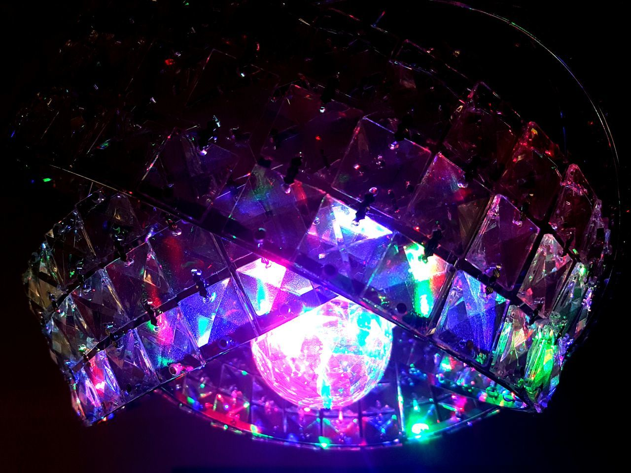Tricked out light fixture Shiny Illuminated No People Luminosity Interior Pattern Light Festive Season Refraction Close-up Colored Background Disco Colors Colours Living Room Fixture Fixture And Fittings