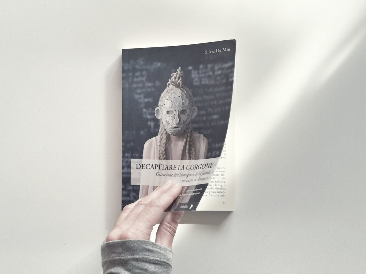 In the front page | Mask My Work My Design Theater Book ANAGOOR My Hand  Holding Close-up Text Still Life Abstract Light And Shadows Personal Perspective Enjoy The New Normal Lifestyles White Album People EyeEm Italy |