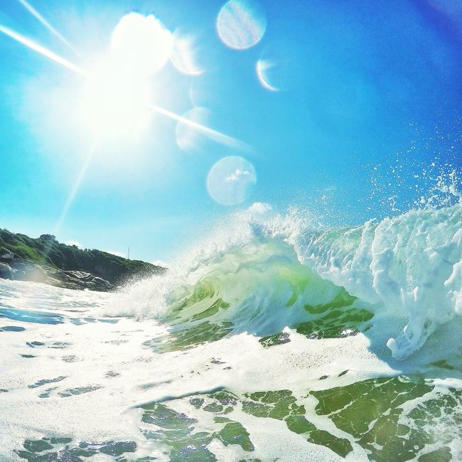 Beauty In Nature Blue Bright Day Lens Flare Mountain Nature Outdoors Power In Nature Scenics Sea Sea And Sky Shore Sky Snow Splashing Sun Sunbeam Sunlight Sunny Tranquil Scene Tranquility Vacations Water Waves