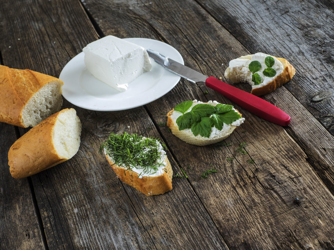 bruschetta with feta cheese and chopped spicy herbs on an old wooden weathered table Background Bread Bruschetta Cheese Chopped Close-up Feta Food Freshness Herbs No People Old Planks Plate Rustic Spicy Table Weathered Wood - Material Wooden