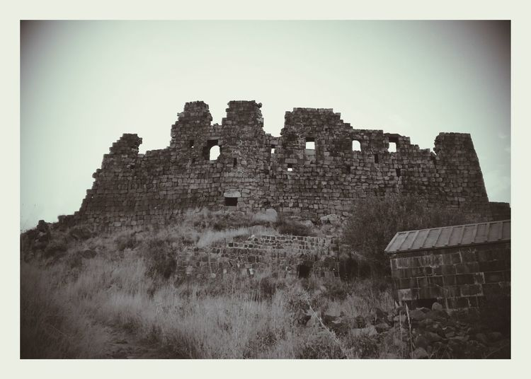 Monochrome Photography Architecture Auto Post Production Filter Old Ruin Clear Sky Low Angle View The Past History Ruined Outdoors Stone Old Fortresss Of Amberd Armenia Huaweip9lite Sky