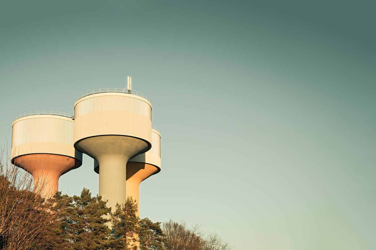Tree Architecture Water Tower - Storage Tank Low Angle View Storage Tank Global Communications No People Outdoors Day Sky Urban Geometry Architectural Feature Architectural Detail Exceptional Photographs Hello World EyeEmNewHere Urban Architecture Urban Buildings & Sky Clear Sky Built Structure Building Exterior Building Architectural Column Water Tower The Street Photographer - 2017 EyeEm Awards The Architect - 2017 EyeEm Awards The Photojournalist - 2017 EyeEm Awards