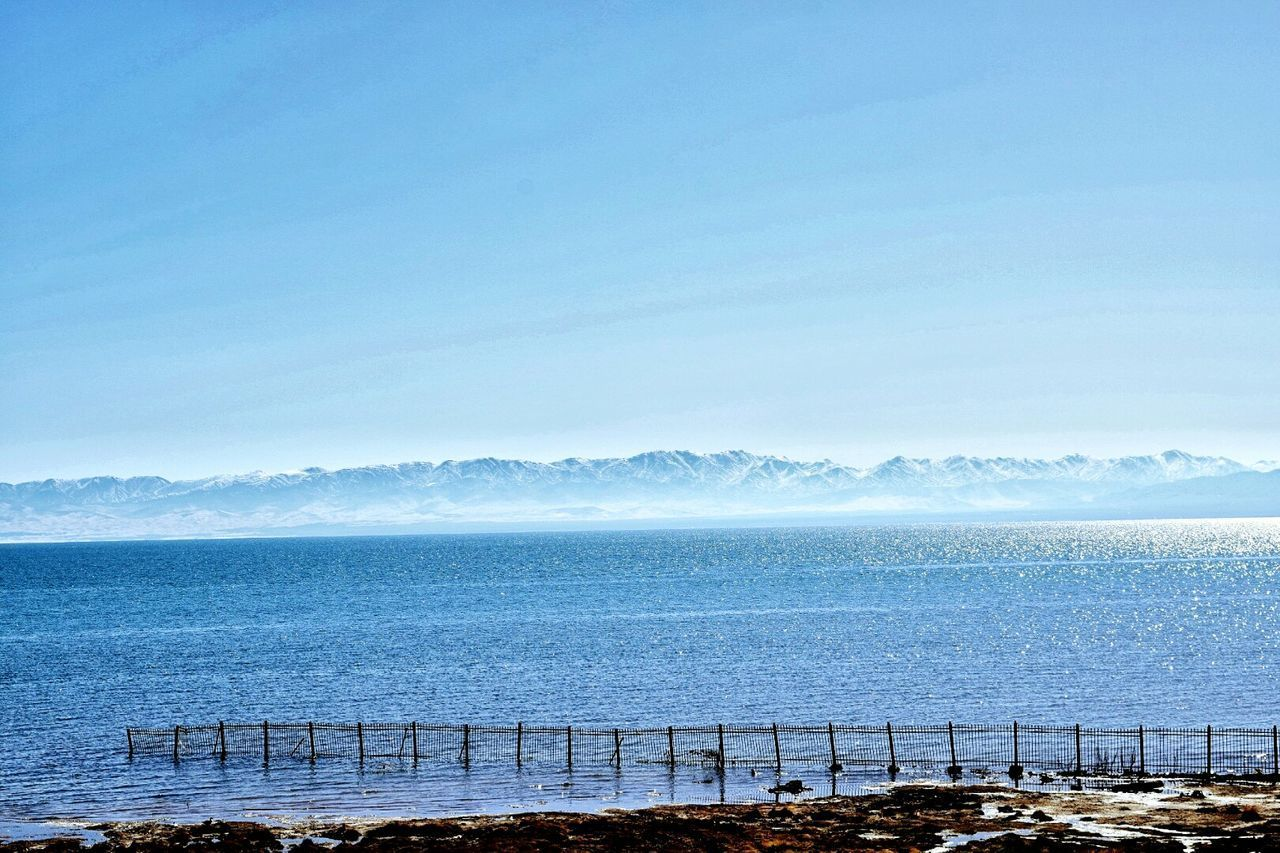 water, sea, beauty in nature, scenics, nature, tranquil scene, tranquility, no people, copy space, day, outdoors, mountain, horizon over water, blue, sky, clear sky, mountain range, landscape