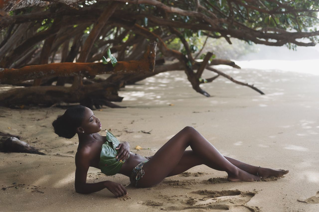 Beach Sand One Person Relaxation Beautiful Woman Nature Beauty In Nature