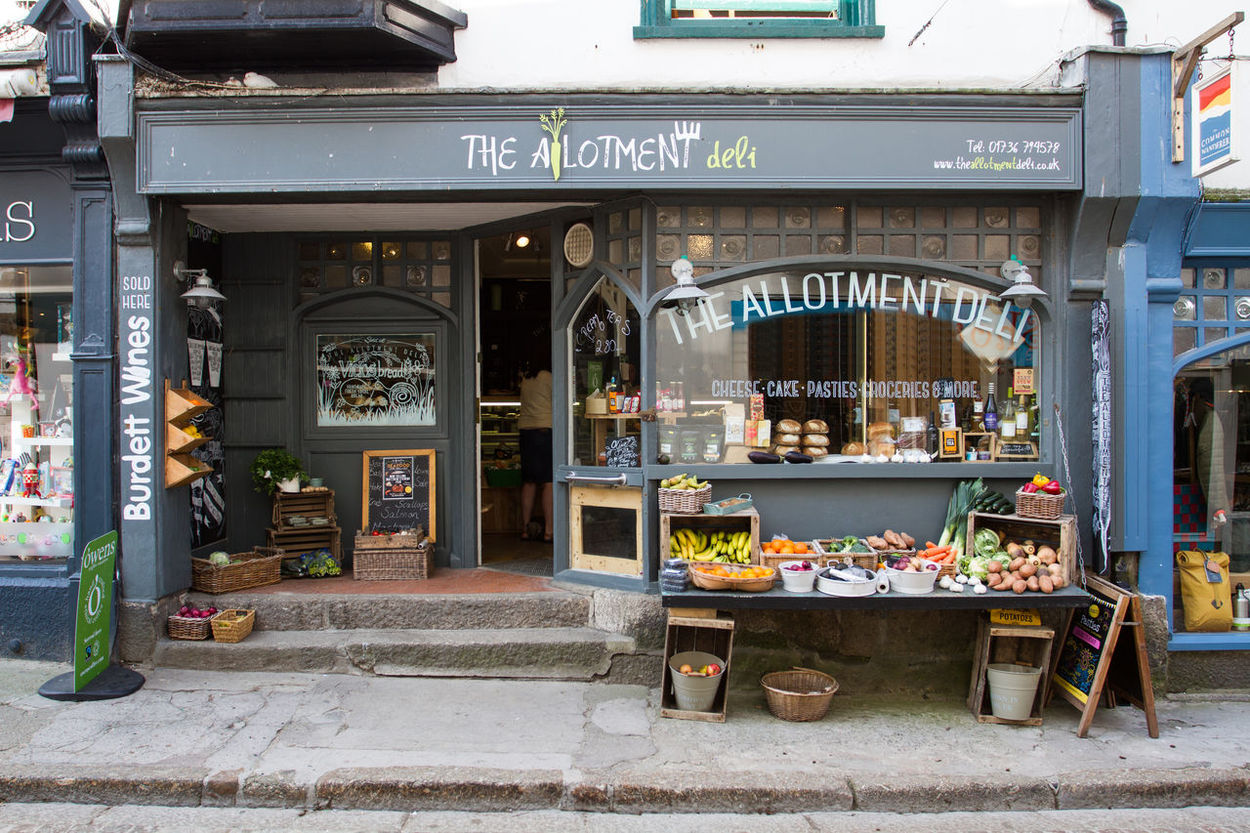 The external shop front of The Allotment Deli in St Ives, Cornwall, UK which sells local produce to local people. Allotment Allotment Deli Day Deli External Food Food And Drink Front View Frontage Garden Produce Gardening Local Produce Market Market Stall Marketplace No People Outdoors Outside Produce Shop Shop Front Store Storefront Uk Vegetables