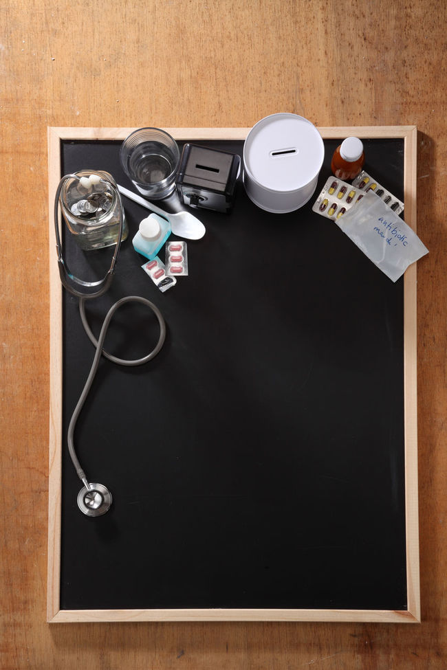 Antibiotic Backgrounds Bank Banking Blackboard  Cash Coin Coin Box Collage Concept Container Cough Syrup Education Finance Glass Jar High Angle View Income Invest No People Photography Piggy Piggybank Retirement Save Stethoscope  Studio Shot