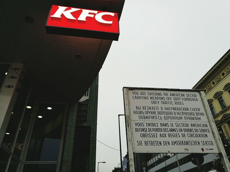 Street Berlin Checkpointcharlie KFC American Sector Travel Destinations Built Structure No People Outdoors Road Sign Day Communication
