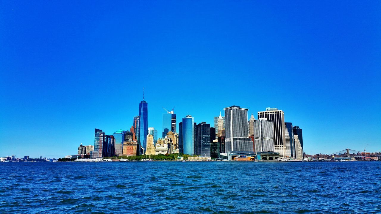 EyeEmonGI Manhattan Blue Waterfront Architecture Built Structure Building Exterior Clear Sky Water City Copy Space Skyscraper Sea Cityscape Water Surface In Front Of Wide Urban Skyline Tall - High Scenics Ocean Skyline