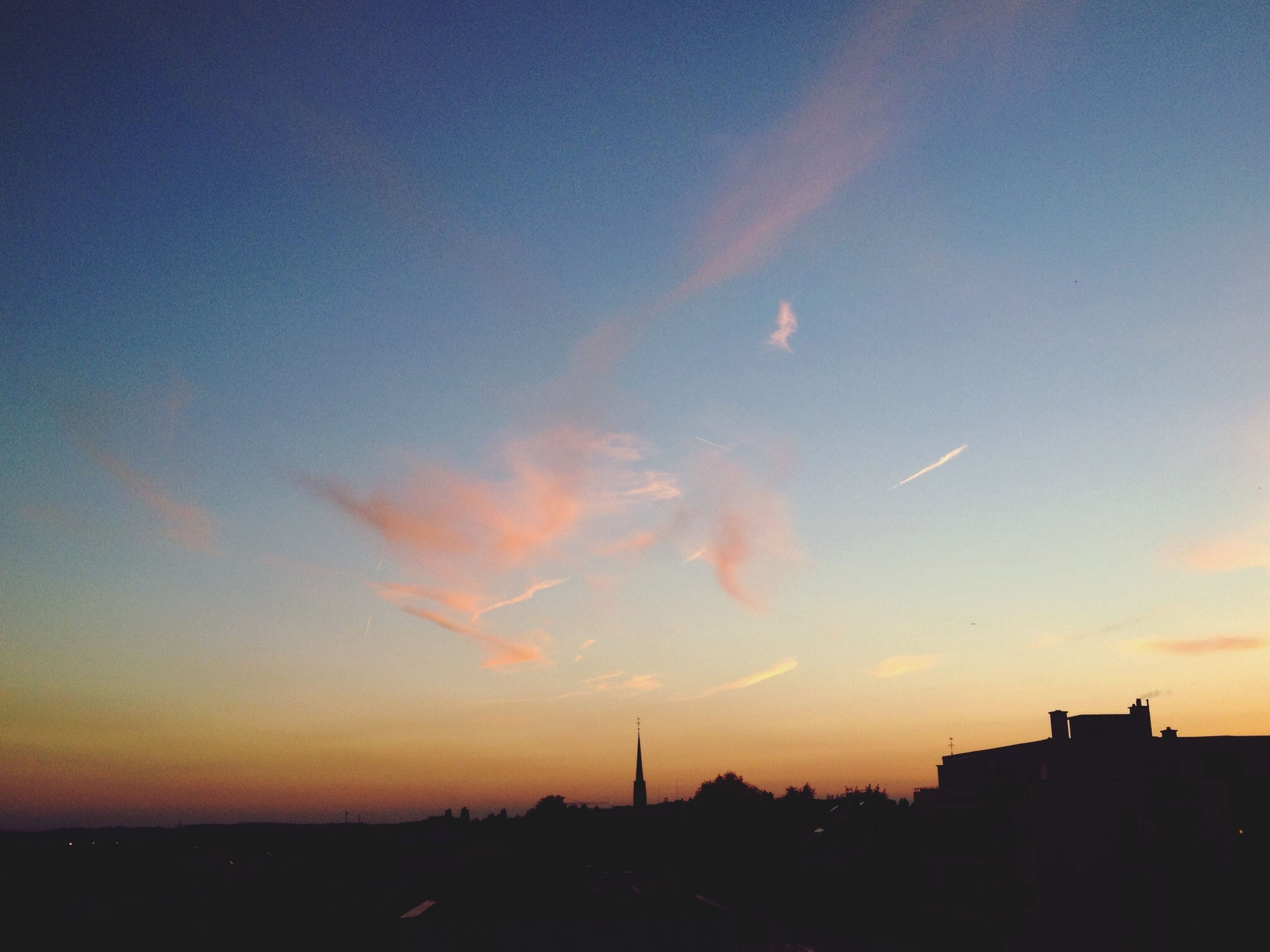 sunset, silhouette, building exterior, orange color, sky, scenics, built structure, beauty in nature, architecture, nature, city, dusk, tranquility, tranquil scene, landscape, idyllic, cityscape, outdoors, copy space, dark
