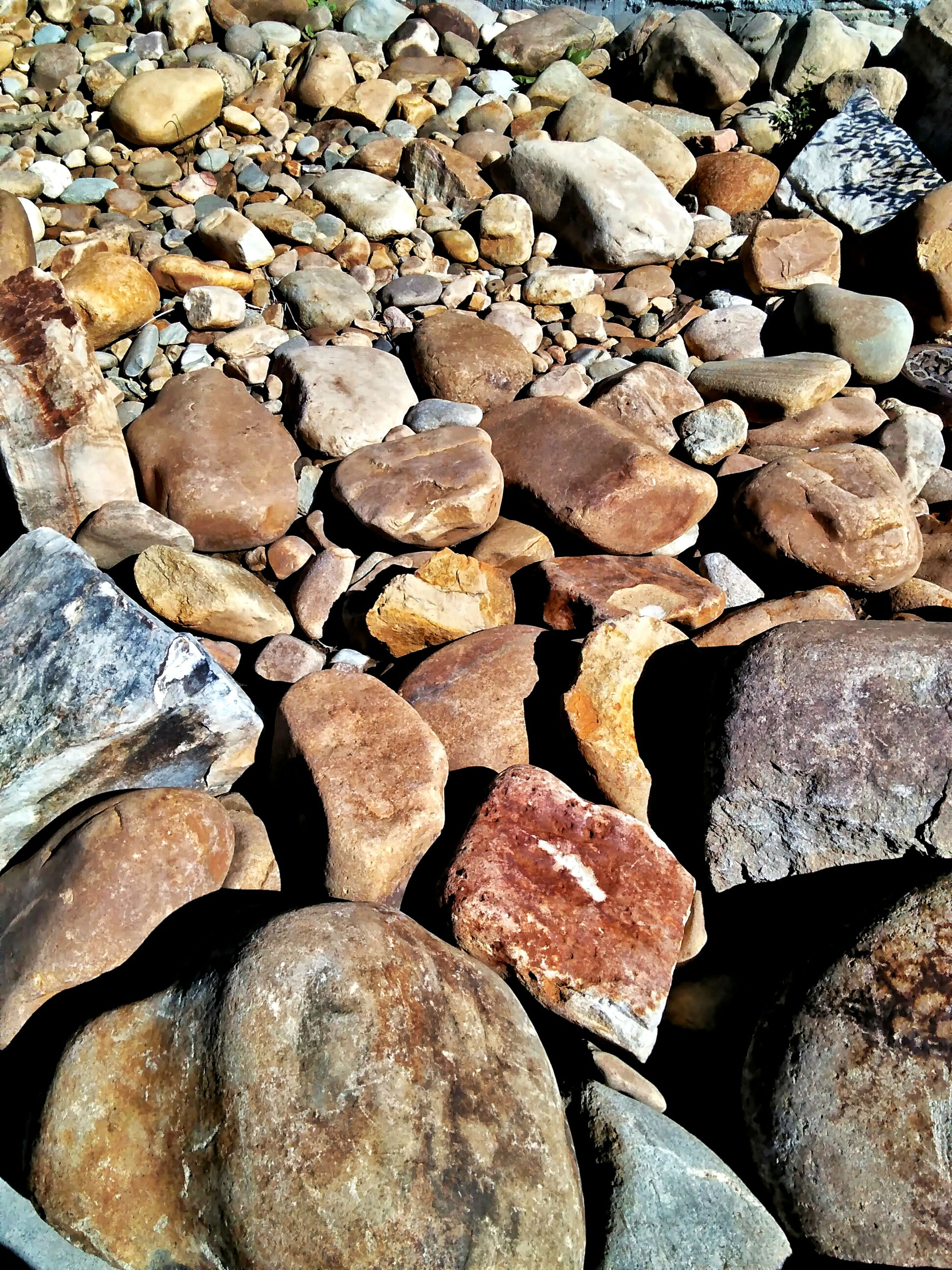 abundance, full frame, backgrounds, rock - object, stone - object, large group of objects, day, nature, sunny, outdoors, tranquility, stone, rock formation, tranquil scene, no people, scenics, beauty in nature, non-urban scene