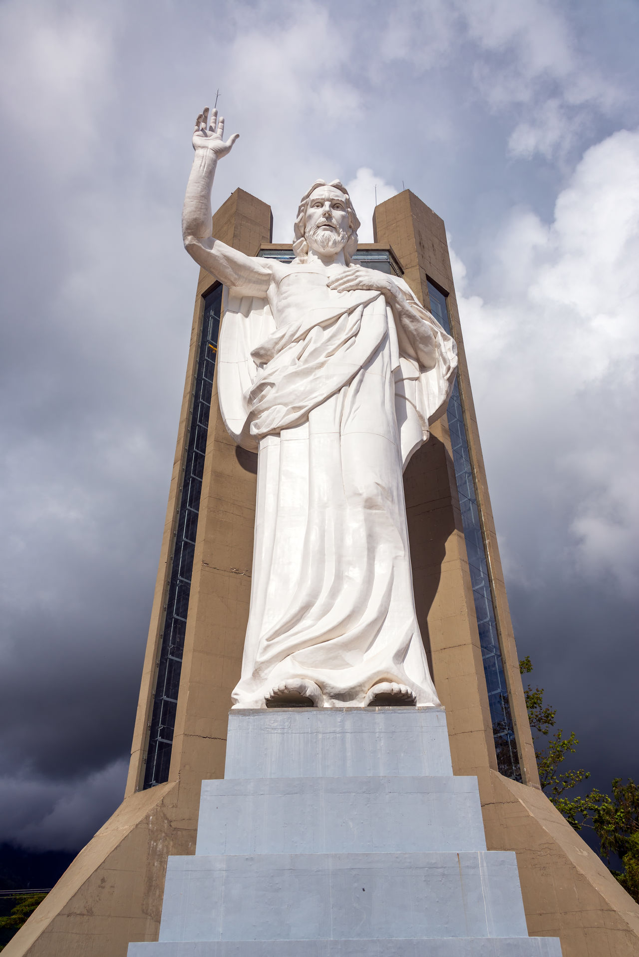 Vertical view of El Santisimo statue of Jesus Christ with a dramatic sky in Floridablanca, Colombia Bucaramanga Building Catholic Cerro Christ Christianity City Cloud Clouds Colombia Ecoparque Elsantisimo Floridablanca Jesus Landmark Park Religion Santander Santisimo Sculpture Statue Structure Urban View White