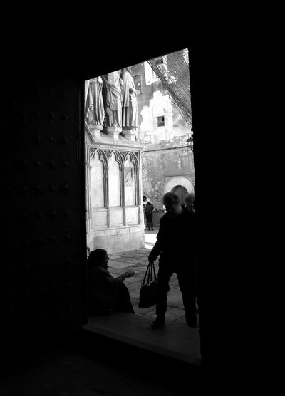Arch Architecture Building Built Structure Casual Clothing Day Full Length Leisure Activity Lifestyles Mammal Woman Begging At The Door Of The Cathedral Of Tarragona