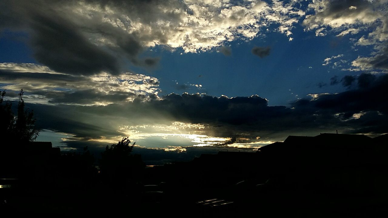 sky, silhouette, cloud - sky, no people, nature, sunset, outdoors, sunlight, beauty in nature, architecture, city, day