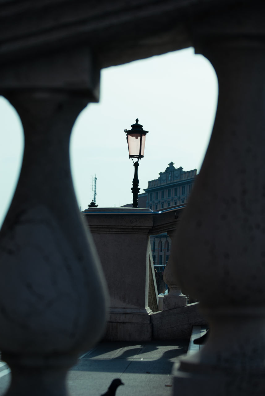 architecture, built structure, building exterior, bridge - man made structure, arch, street light, day, low angle view, gas light, no people, clear sky, outdoors, statue, city, sky
