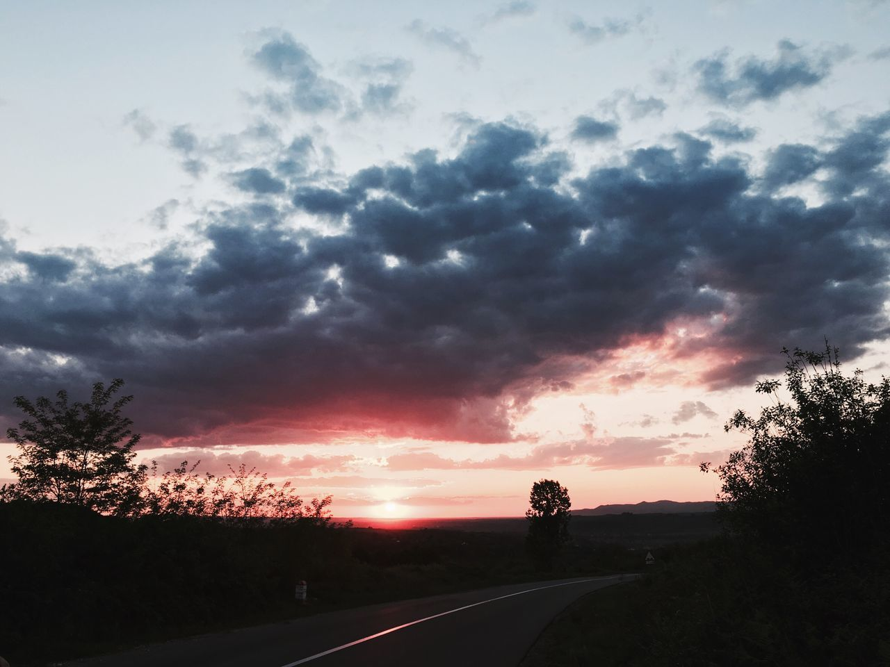 road, tree, sunset, the way forward, sky, cloud - sky, transportation, silhouette, nature, scenics, tranquility, tranquil scene, beauty in nature, outdoors, no people, landscape, day