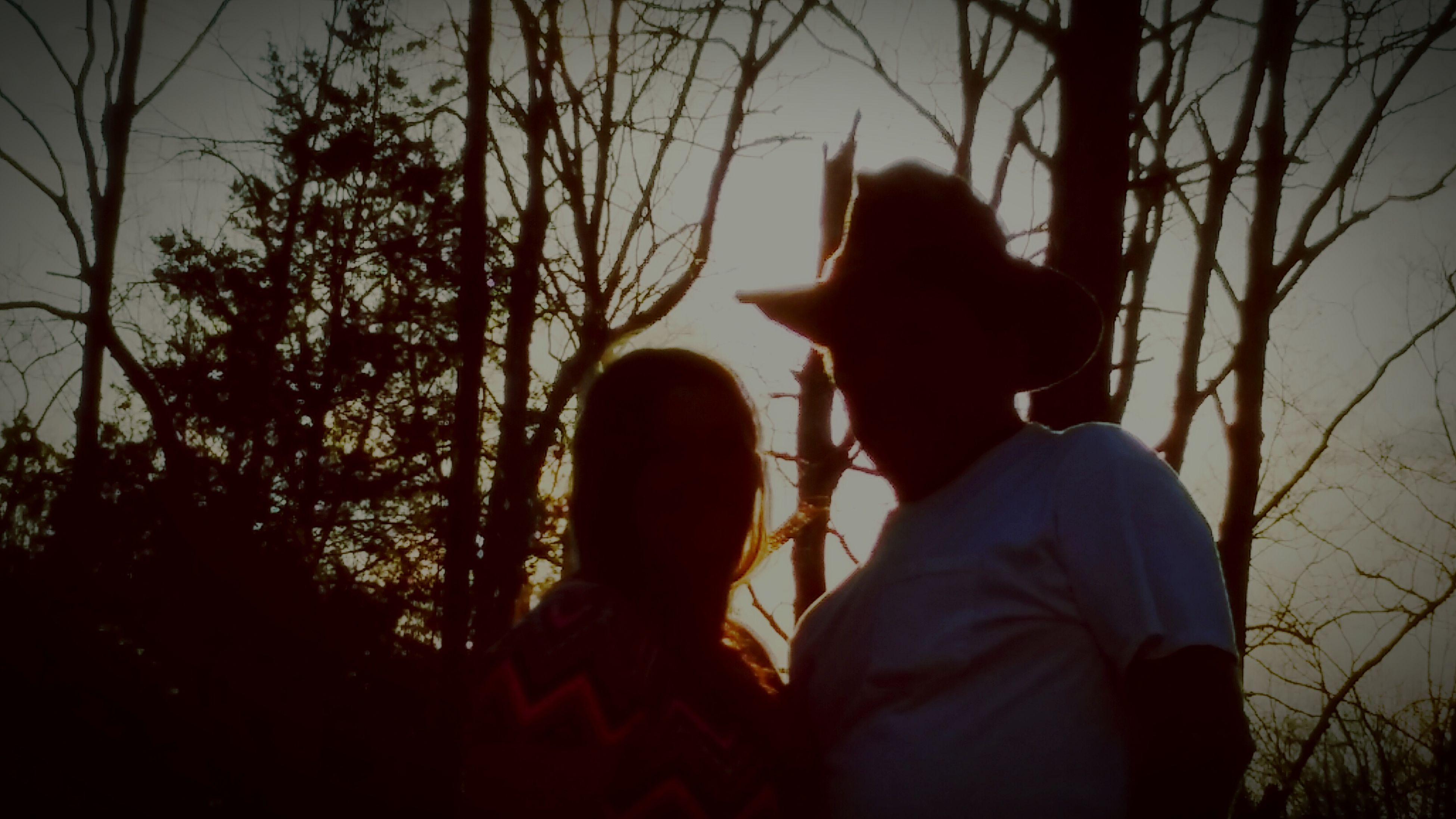 two people, tree, real people, silhouette, headshot, lifestyles, sunset, men, outdoors, sky, bonding, nature, togetherness, day, close-up, people, adult
