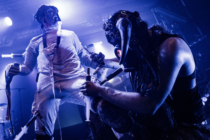 Alternative Music Concert Electronic Music Shots Headwear Horror Horror Show Krakow Low Angle View Music Rock Music Skinny Puppy Stage Light Stage Performance Syringes Weapon