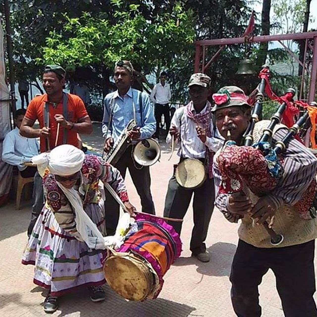 music, musical instrument, arts culture and entertainment, musician, togetherness, performance, outdoors, day, playing, guitar, real people, adult, performance group, teamwork, people, adults only, only men