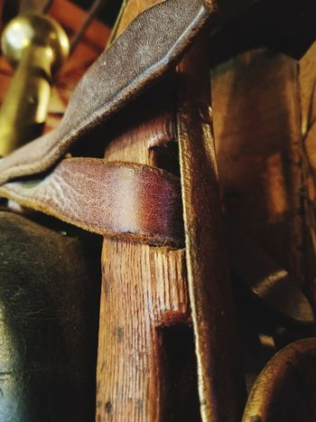 Close-up No People Full Frame Textured  Indoors  Backgrounds Day Mode Of Transport Harness Horse Cart Texas Tack Textures And Surfaces Brass Leather Wood Grain