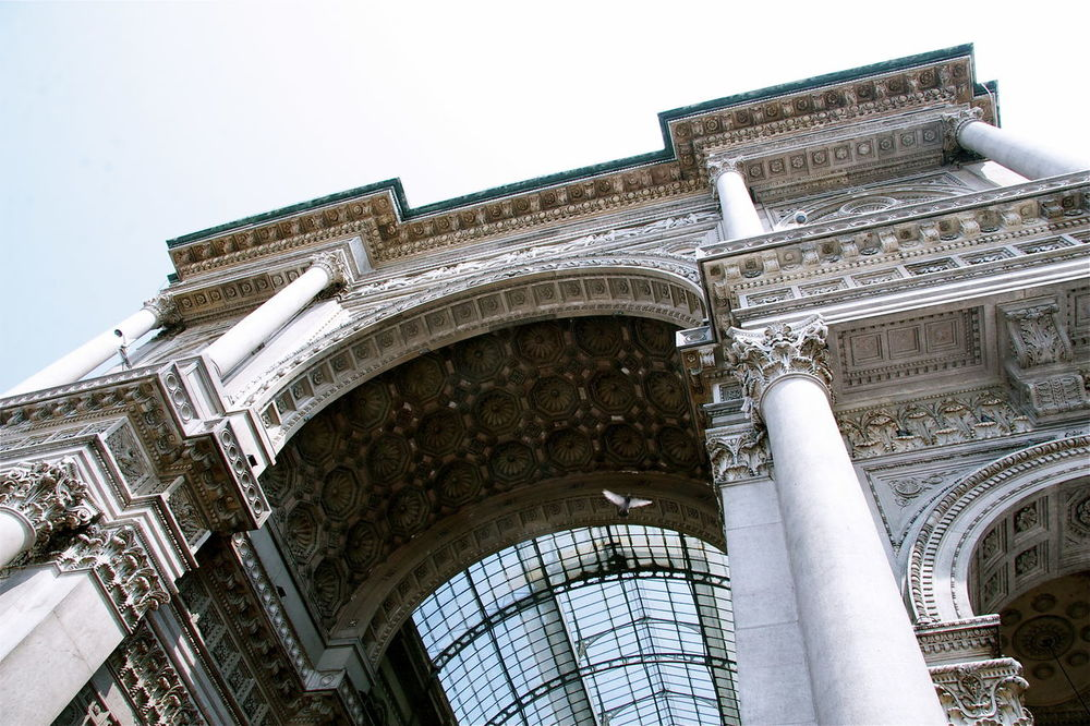 Arch Architectural Column Architecture Bird Built Structure Capitell Capitello City Culture Entrance Famous Place History Beautiful Place Italy Kvission Low Angle View The Architect - 2016 EyeEm Awards Milano Italy Mónica Nogueira. No People Ornate Outdoors Sky Tourism Travel Destinations