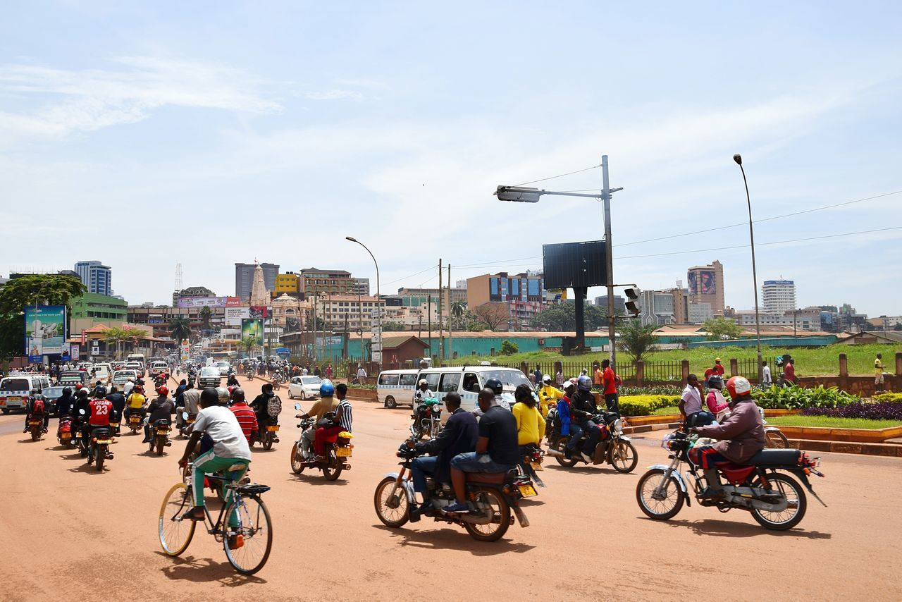 Bicycle Cycling Motorcycle Transportation Mode Of Transport Riding Travel City City Street City Life People Outdoors Sky Land Vehicle Large Group Of People Adult Biker Crowd Day Cityscape Kampala Uganda Let's Go. Together.