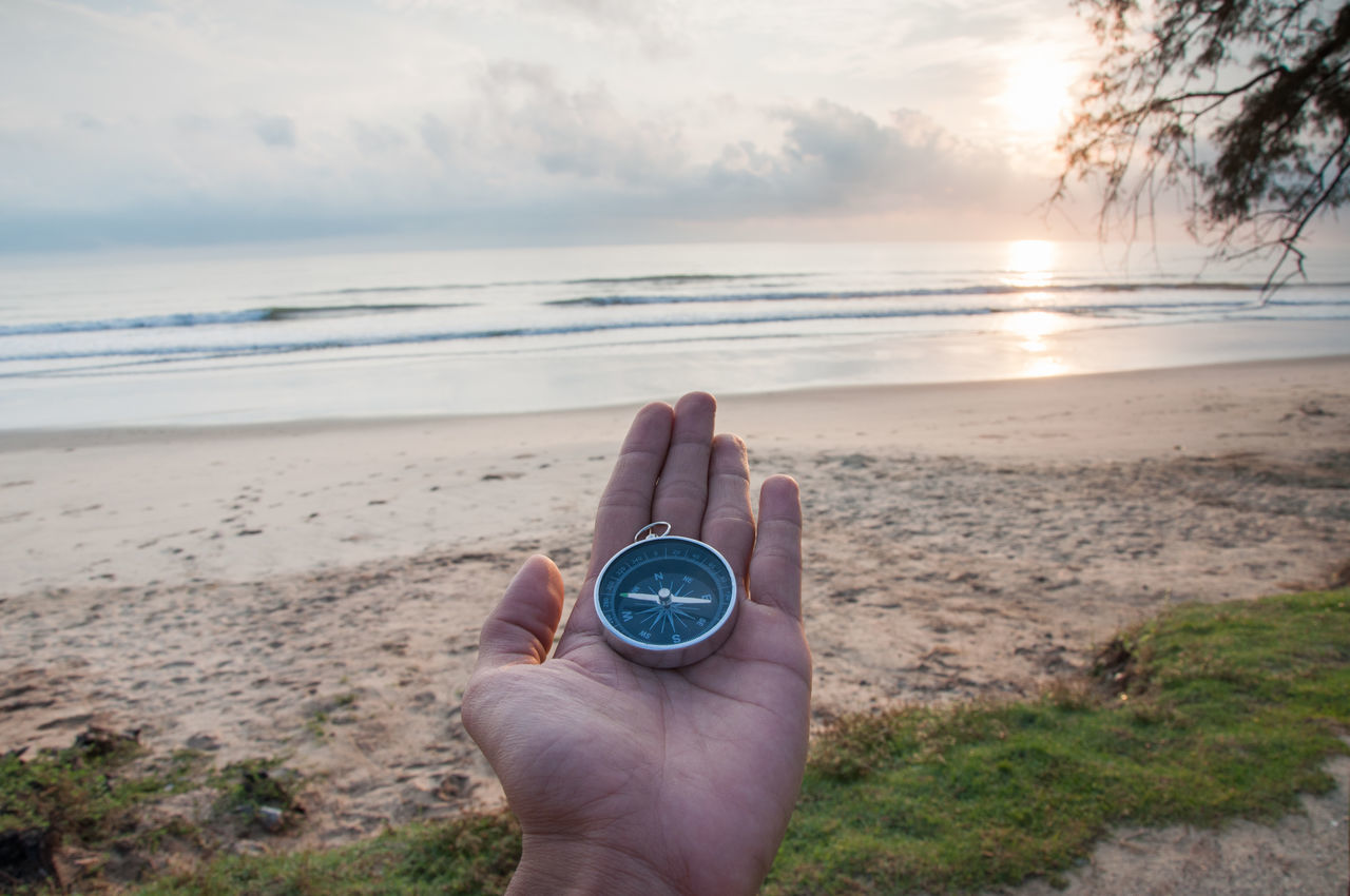 Compass with sunrise background Scenics Outdoors Sunset Sunrise Pahang Beserah Sky And Clouds Nature Beauty In Nature Trekking Compass Navigation Holidays Blue Sky Beach Seascape Malaysia UNSUNG