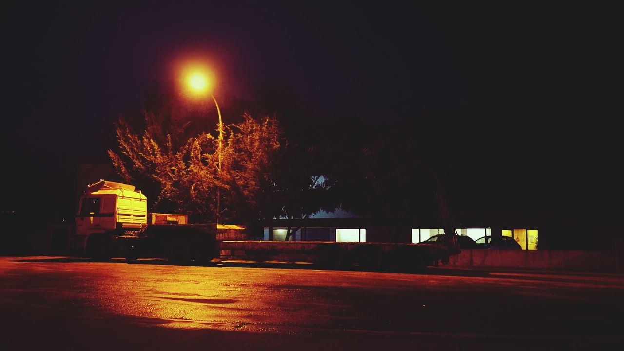 Night Illuminated Transportation Tree No People Vintage Style Outdoors HuaweiP9 Car Lowlightphotography Lowlight Saturatedcolors Randomshot Tire Truck Lorry Transportation Cargo Parking Lot Parked Dontknowwhy