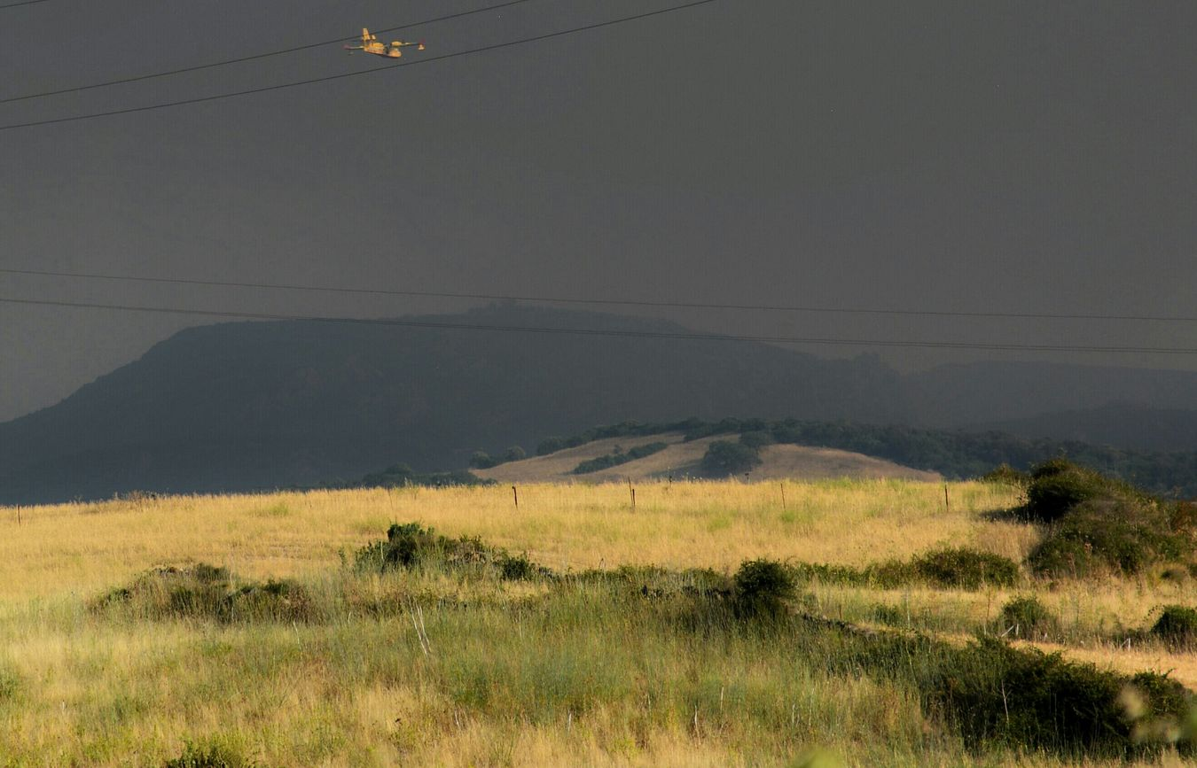 Into the fire. Waterplane Plane Fire Wildfire Farmland Fieldscape Smokey Sardegna Fields Sardinia Sardegna Italy
