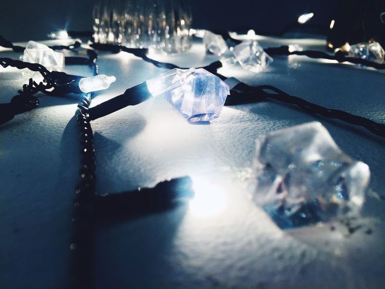 Beautiful Christmas lights close up. Chirsmas Fastival Blue Blue Soft Light Table No People Reflection Indoors  Shiny Luxury Close-up Water Day