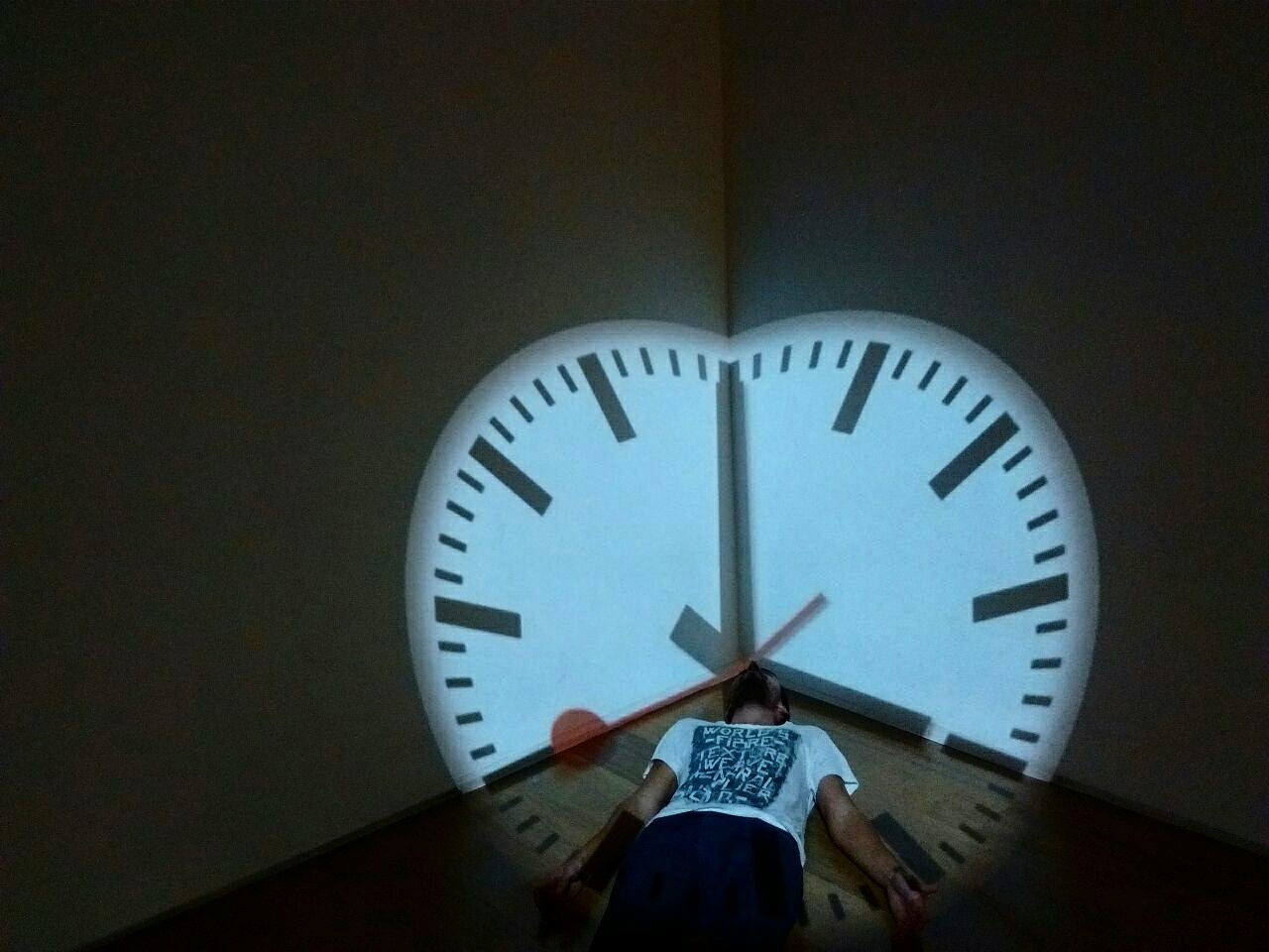 time, real people, one person, clock, indoors, lifestyles, standing, day, clock face, minute hand, hour hand, human hand, people