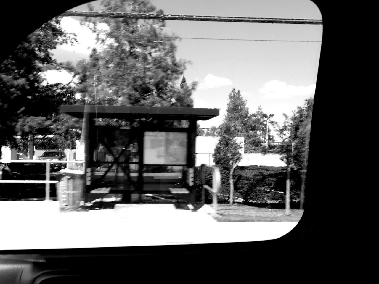 Monochrome Photography The Drive On The Road Motion Motion Blur In The Car Through The Looking Glass Car Window Car Window Views Bus Stop Bus Shelter Nature Light And Shadow Transportation Sunny Day Florida Nature Floridaphotographer Florida Street Streetphotography Snapshots Of Life Blurred Motion Outdoors Random Acts Of Photography Road