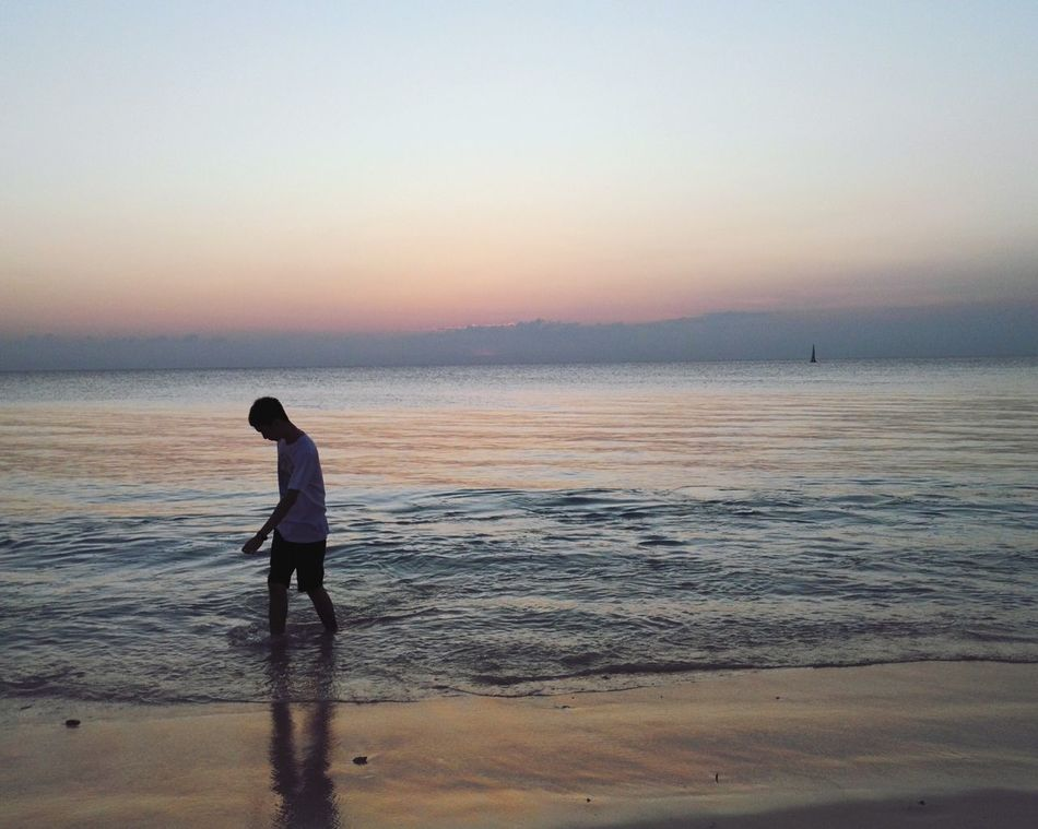 Sea Real People Water Lifestyles Beach Boys Horizon Over Water One Person Full Length Standing Leisure Activity Sunset Outdoors Scenics Beauty In Nature Sky Nature EyeEmNewHere