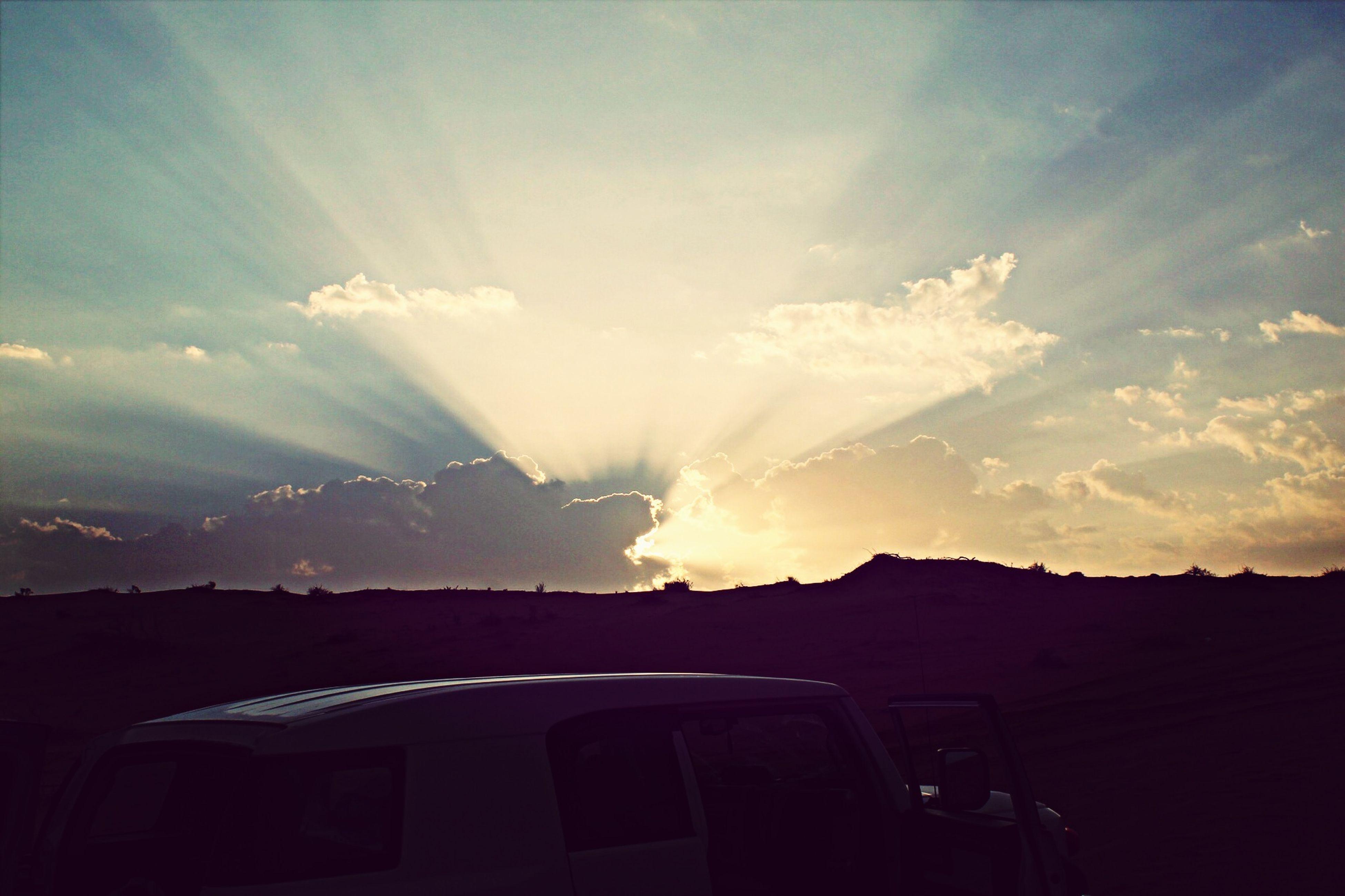 sun, sunbeam, sunset, sky, sunlight, scenics, lens flare, beauty in nature, cloud - sky, landscape, silhouette, nature, tranquil scene, tranquility, mountain, cloud, idyllic, bright, outdoors, building exterior