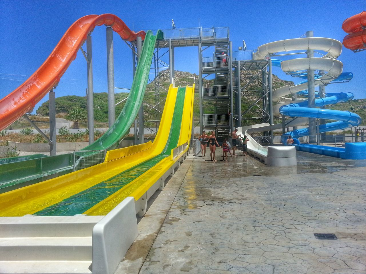 day, built structure, real people, leisure activity, architecture, clear sky, outdoors, sky, nature, water slide