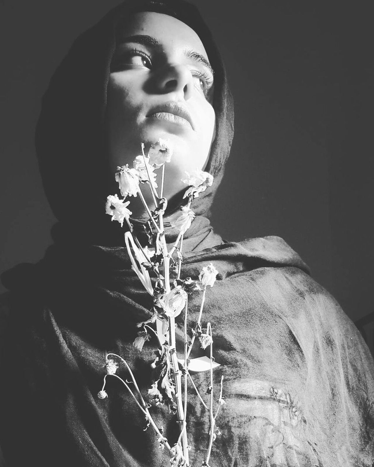 The Portraitist - 2017 EyeEm Awards Young Adult One Person Young Women Old-fashioned Beauty Females Black Background Beautiful Woman Plants Blackandwhite Hijab Studio Shot One Woman Only Adult Sunlight Taking Photo Italy Creative Light And Shadow Close-up Taking Photos Selfportrait