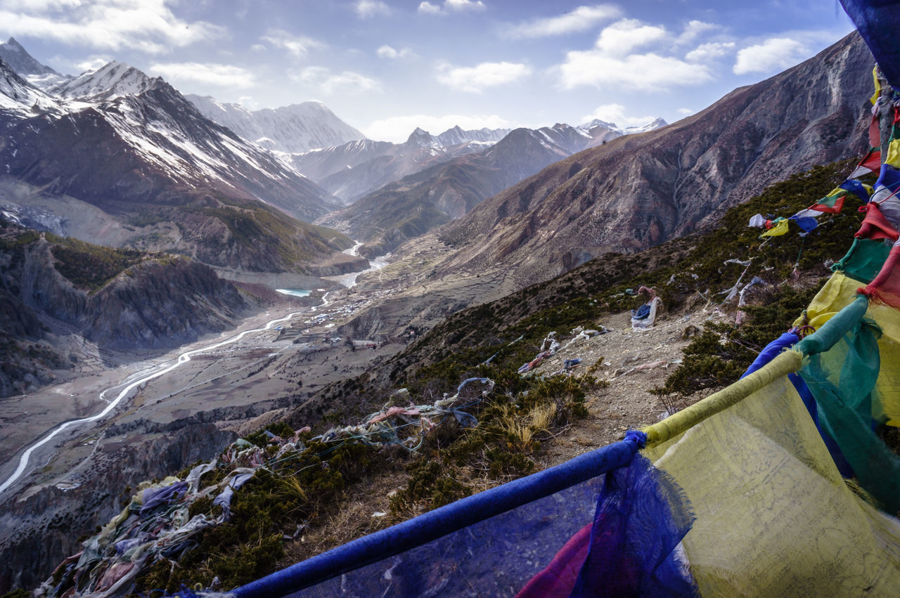 Looking towards Manag on the Annapurna Circuit Adventure Beauty In Nature Day Glacial High Landscape Mountain Mountain Range Nature No People Outdoors Prayer Flags  Range Scenery Sky Snow