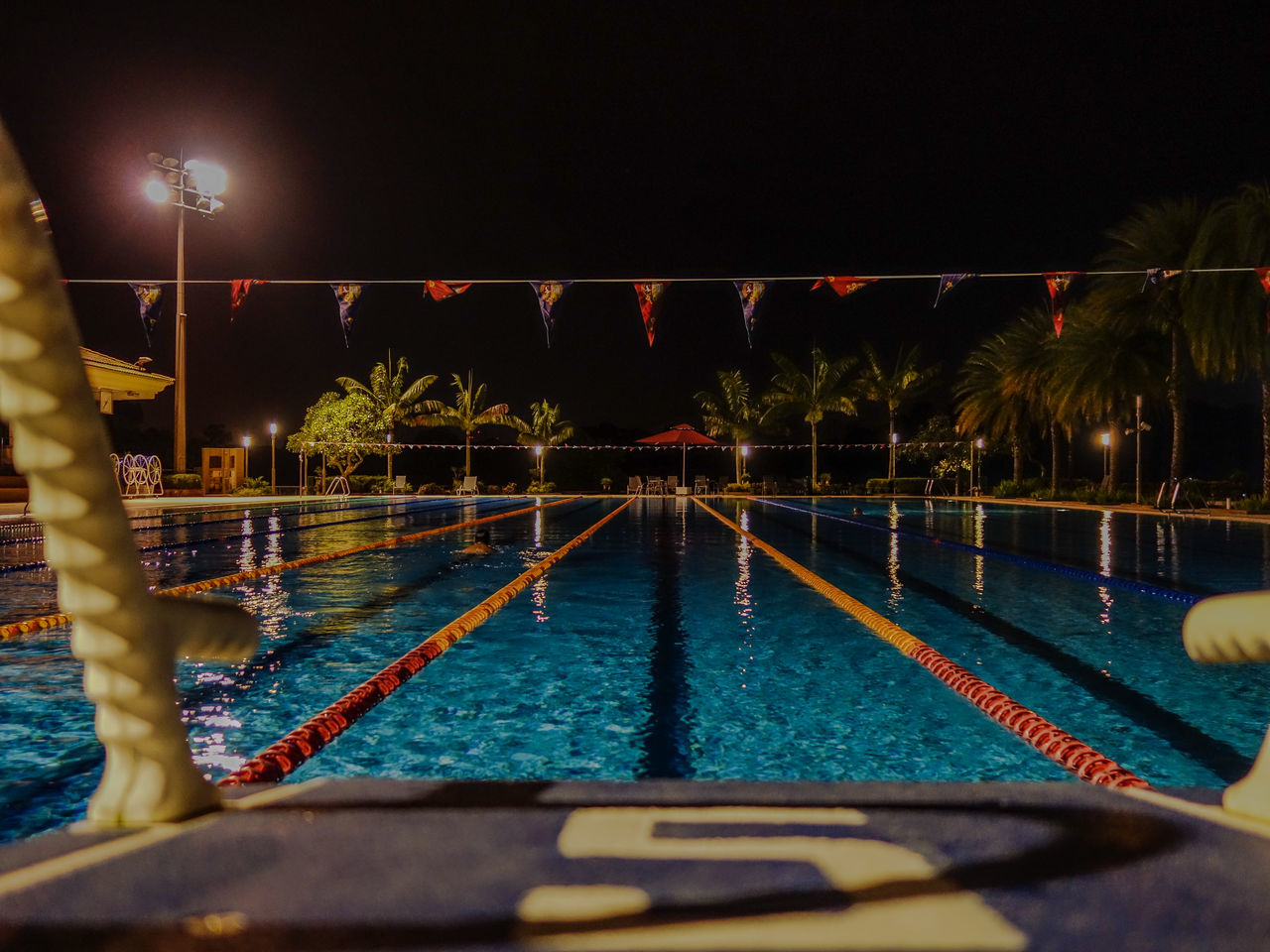 night, swimming pool, illuminated, water, competition, swimming lane marker, outdoors, real people, sky