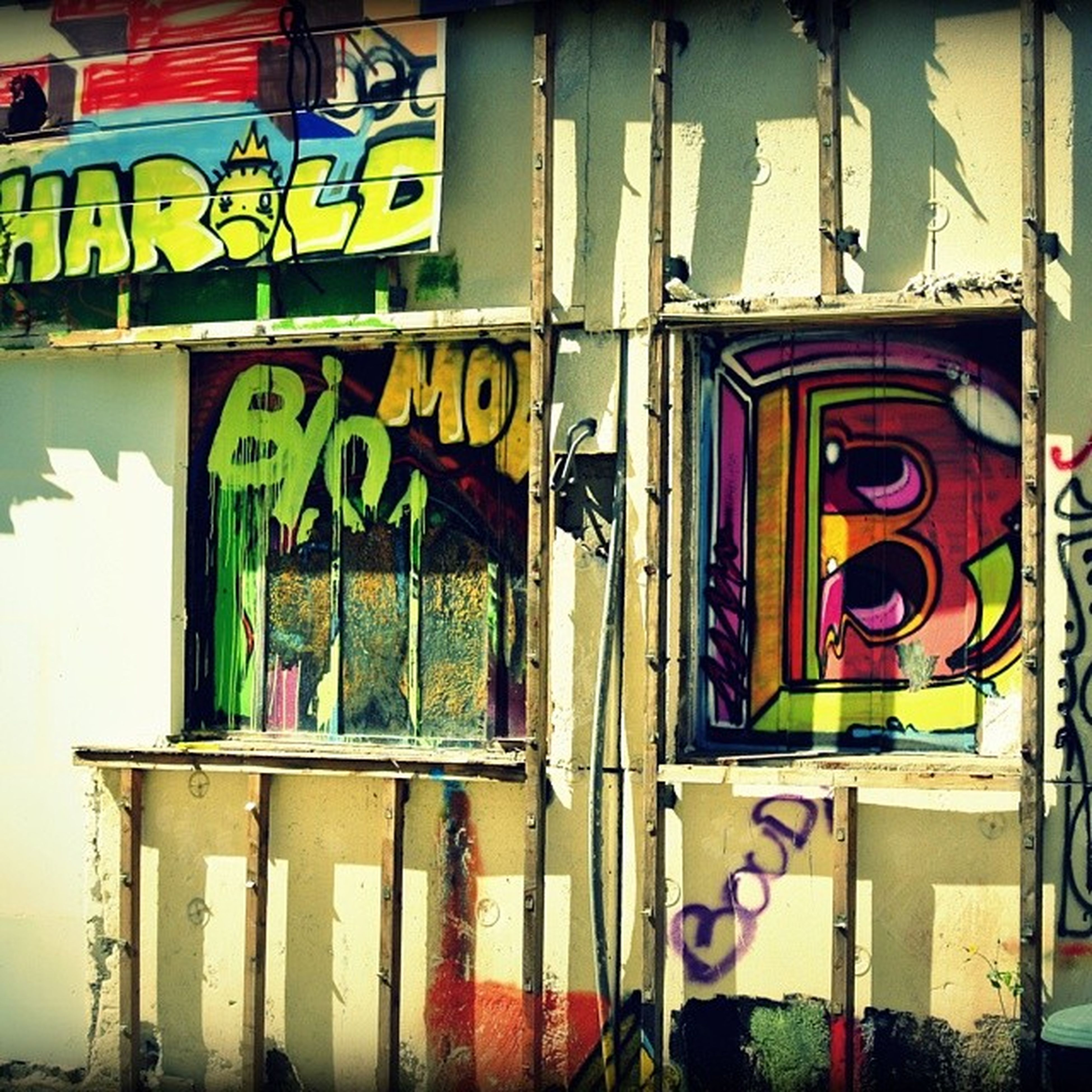 graffiti, built structure, architecture, multi colored, text, wall - building feature, building exterior, western script, art, communication, art and craft, window, creativity, wall, day, no people, vandalism, building, non-western script, store