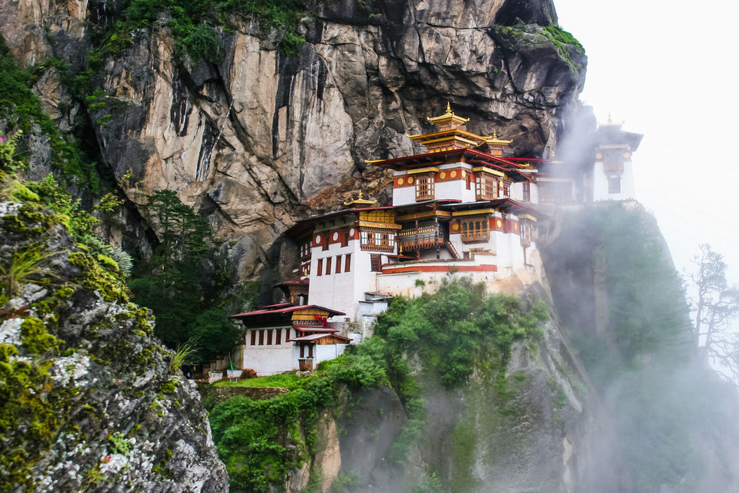 Taktsang (Tiger's Nest) Monastery enshrouded in clouds. For me this image is what represents Bhutan: magical, mysterious and idyllic Architecture Architecture Beauty In Nature Bhutanese Dzong Idyllic Monastery No People Outdoors The Architect - 2017 EyeEm Awards The Great Outdoors - 2017 EyeEm Awards Rock Formation Taktsang Monastery Tiger's Nest Travel Travel Destinations Buddhism