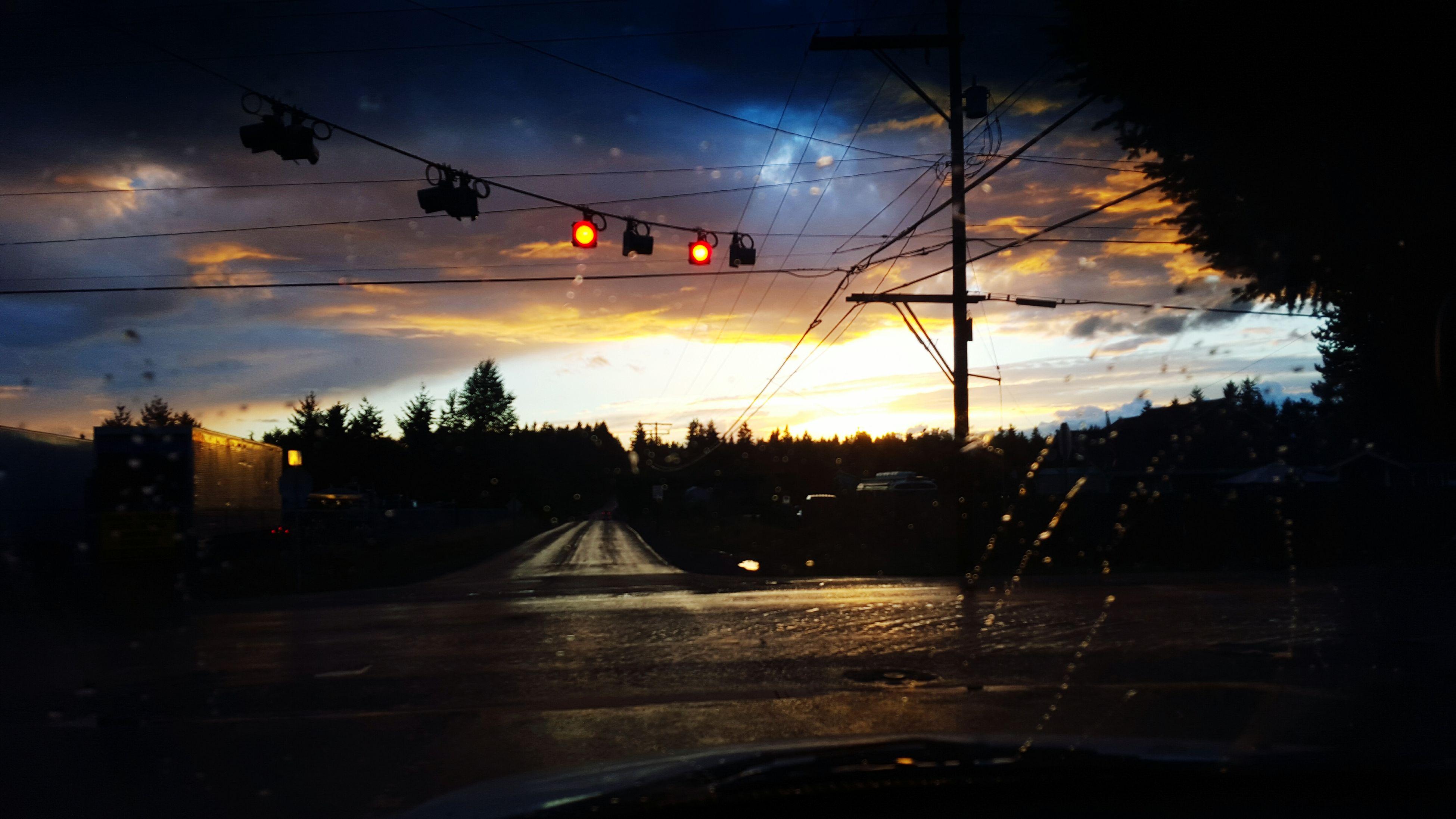 sunset, sky, transportation, silhouette, cloud - sky, power line, electricity pylon, car, land vehicle, road, mode of transport, dusk, tree, power supply, street, electricity, orange color, cloudy, cloud, street light