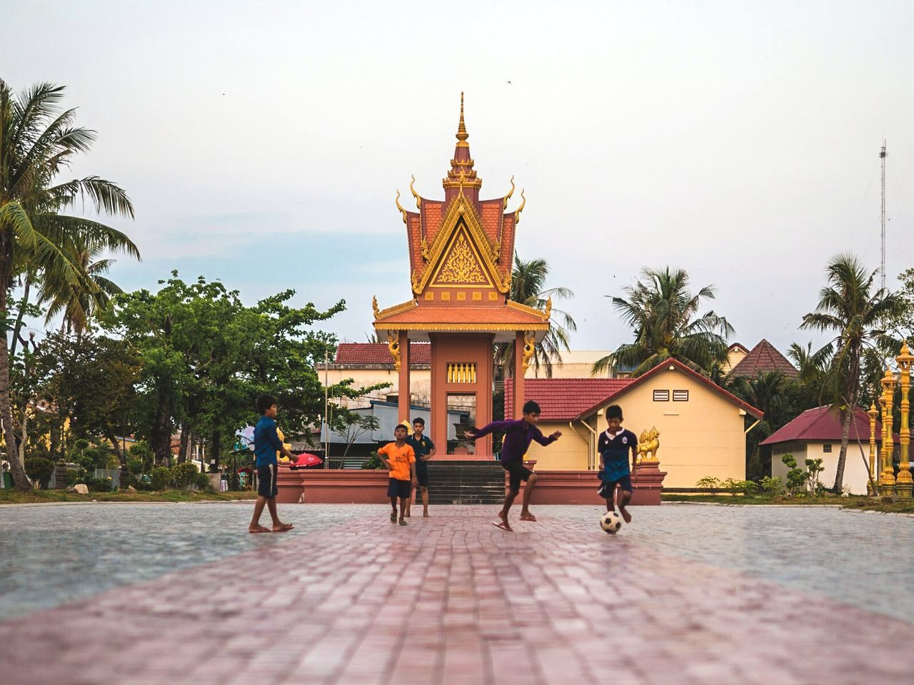 Tiebreaker Architecture Religion Travel Destinations History Tourism Gold Sky King - Royal Person Outdoors People Arts Culture And Entertainment Kids Kids Being Kids Playing Soccer Cambodia Real People ASIA Travel Photography Showcase: April Togetherness Lifestyles City Real Life Happiness