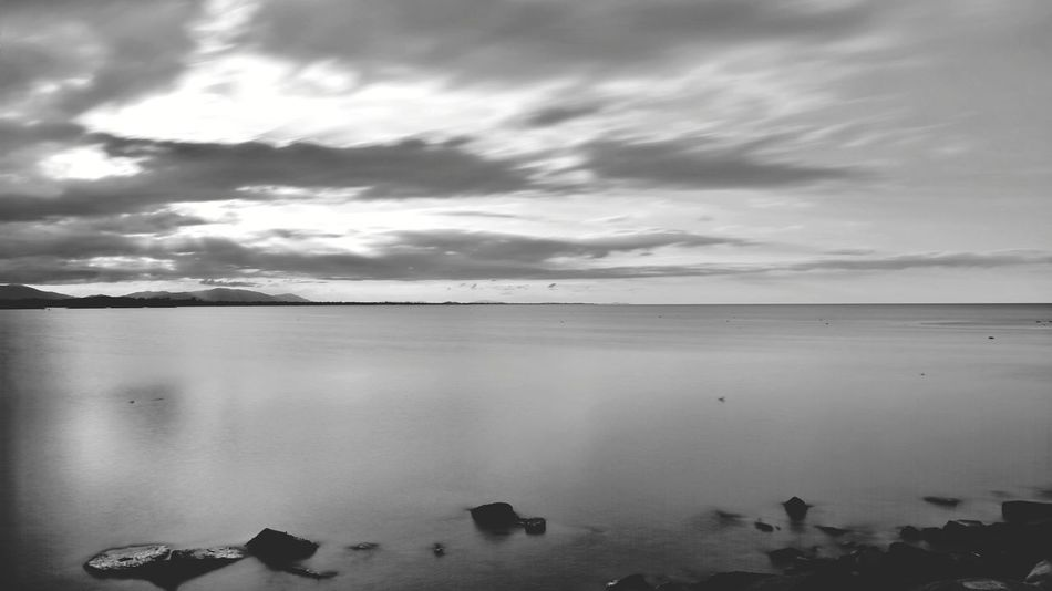 In mono Sunset Beach Cloud - Sky Reflection Outdoors Water Sea Nature Landscape Sky Sand Horizon Over Water Scenics Sun Tranquility Beauty In Nature Swimming Low Tide Day Phone Photography P10 No People Scenery