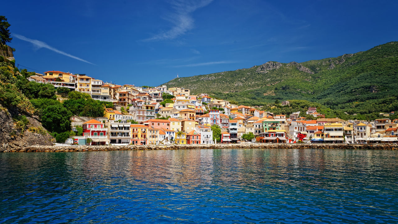 Arrival At Parga Architecture Blue Building Exterior Built Structure City Day Greece House Mountain Nature No People Outdoors Parga Sea Sky Town Water Waterfront