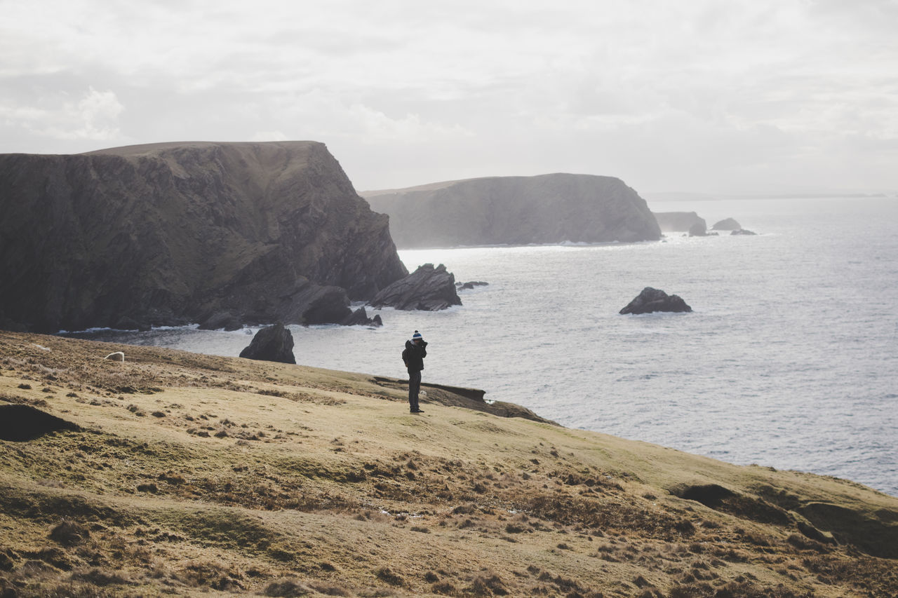 Hermaness, Unst Island Adults Only Adventure Atlantic Ocean Beauty In Nature Cliff Cloud - Sky Coastline Hiking Horizon Over Water Men Nature Outdoors Photographer Real People Rock - Object Scenics Travel Water Neighborhood Map The Great Outdoors - 2017 EyeEm Awards Live For The Story Place Of Heart